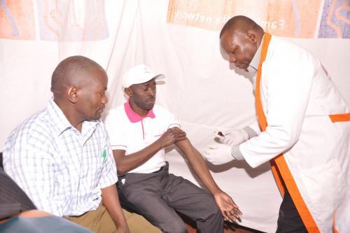 PETER WACHIRA AND FESTUS KABURI,FACTORY UNIT MANAGER HAVE  BLOOD TEST DURING MEDICAL CAMP AT KAG2
